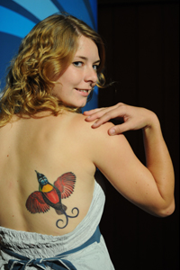 Girl with the bird of paradise tattoo